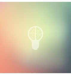 Lightbulb icon on blurred background vector