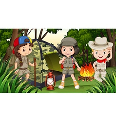 Children camping in the deep forest vector