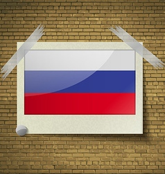 Flags Russiaat frame on a brick background vector