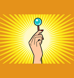Lollipop in female hand vector