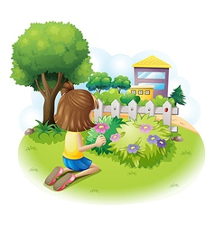 A girl picking flowers vector image vector image