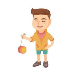 Caucasian boy playing with yo-yo vector