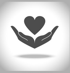 Hand and heart icon vector