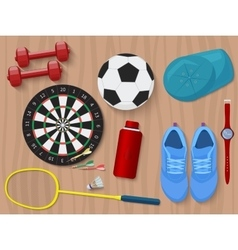 Sports equipment on wooden floor Shoes darts vector image