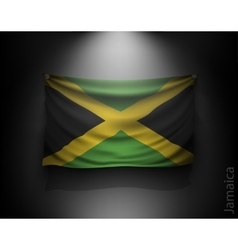 Waving flag jamaica on a dark wall vector