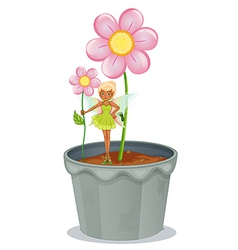 A fairy holding a flower standing on a flower pot vector image
