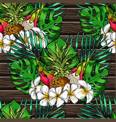 Tropical leaves and exotic flowers on wooden vector