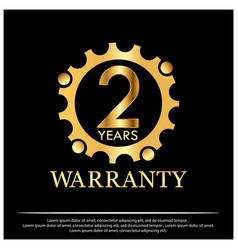 Two year warranty golden label on black background vector