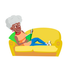 Old woman laying on couch and reading book vector