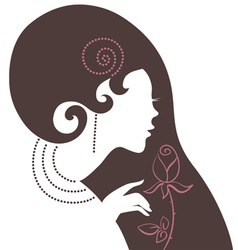 beautiful woman silhouette with a flower vector image vector image