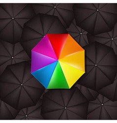 Color Umbrella Against Black Umbrellas vector image