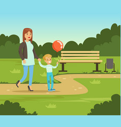 mother and her son walking in summer park outside vector image