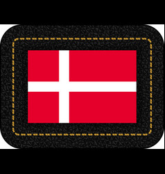 flag of denmark icon on black leather backdrop vector image