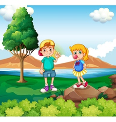 Two kids at the riverside vector image vector image