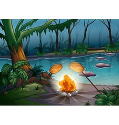 A bonfire in a jungle vector