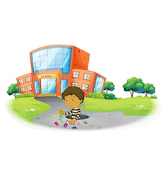 A boy playing in front of the school building vector image
