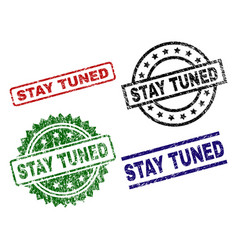 Grunge textured stay tuned seal stamps vector