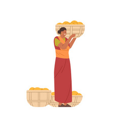 Happy indian woman holding basket full of mango vector