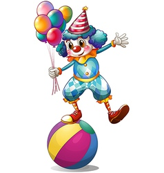 A clown holding balloons above the ball vector image