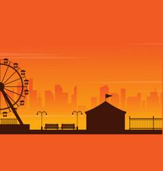 amusement park landscape silhouette at sunset vector image