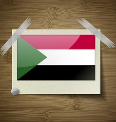 Flags Sudan at frame on wooden texture vector
