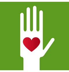 Heart in Hand on green background vector image