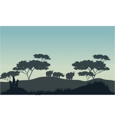Meerkat and rhino silhouette in savannah vector