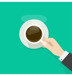 Hand holding hot coffee cup with steam on plate vector image vector image