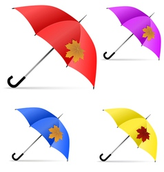 Set of umbrellas with maple leaf vector image