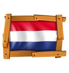 flag of netherland in wooden frame vector image vector image