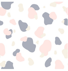 Seamless pattern of pink gray and white spots vector