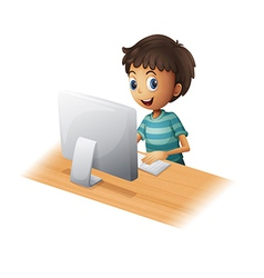 a boy playing computer vector image
