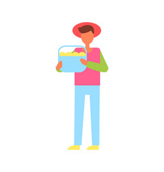 man holding full basket of fruit icon vector image