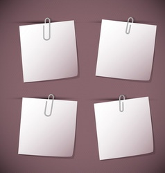 Note papers with paperclip on violet background vector