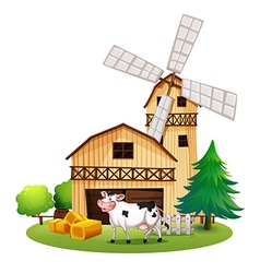 A cow in front of the barnhouse vector image vector image