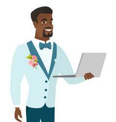Young african-american groom using a laptop vector
