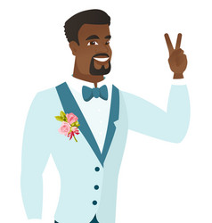 Young african groom showing the victory gesture vector