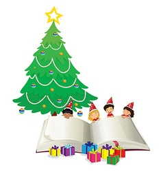 Big book and children by christmas tree vector