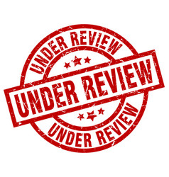 under review round red grunge stamp vector image vector image
