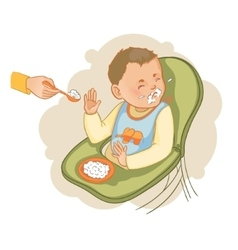 Baby boy in the baby chair refuses to eat pap vector image