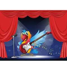 A parrot with a guitar at the stage vector image