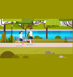 young fit couple jogging outdoors in modern public vector image