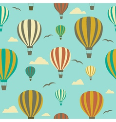 Seamless background with hot air balloons vector
