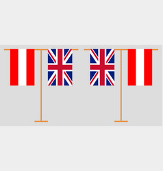 The austrian and british vertical flags vector