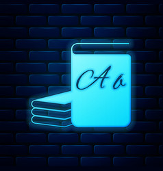 Glowing neon abc book icon isolated on brick wall vector