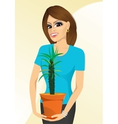 smiling woman holding Pachypodium cactus vector image vector image