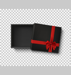 Opened black empty gift box with red ribbon vector