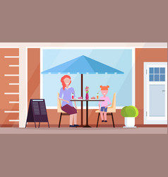 mother with daughter sitting modern summer cafe vector image