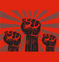 Three clenched raised fists vector