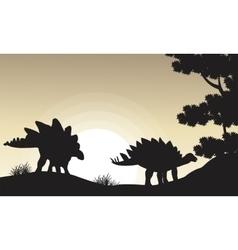 Silhouette of two stegosaurus scenery vector